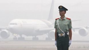 A Chinese paramilitary policeman on the tarmac at Beijing airport