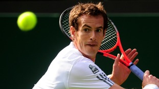 Andy Murray seen in action on day one of the Wimbledon Championships
