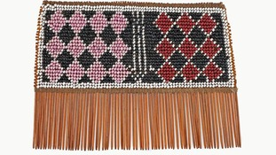 Hair comb made of bamboo, palm leaf,  and cotton thread from Malawi