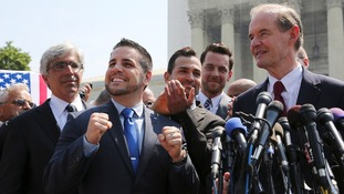 Jeff Zarrillo (2nd left) and Paul Katami (3rd left) and their lawyers announce the decision outside the Supreme Court in Washington.