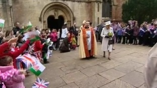 Queen walking pout of Cathedral