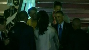 Obama stepping off Air Force One in Dakar