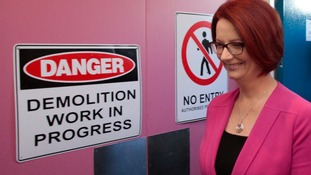 Julia Gillard walks past a demolition sign during a visit Forrest Primary School in Canberra last month.