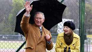 The Prince of Wales watching a cycle race on the Isle of Man