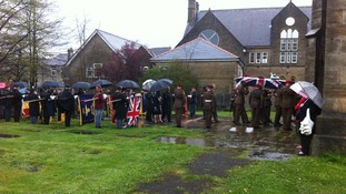 Corporal Jack Stanley's coffin arrives at Holy Trinity Church, Littleborough
