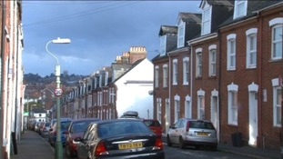 Modern street in Exeter with gap for bombed out house