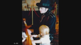 Michael Jackson plays the piano to a young Prince.