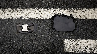 Rider beware: Tour riders run the risk of 'coming a cropper' on British potholes.