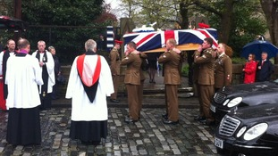 Corporal Jack Stanley's coffin leaves church