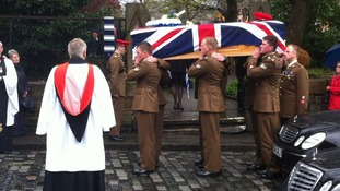 Corporal Jack Stanley's coffin leaves church for a private cremation
