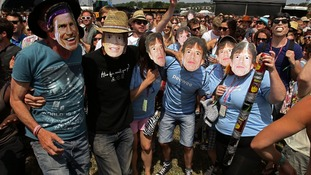 Festival goers dancing to the music of The Rolling Stones during a 'Jagger off' flashmob,