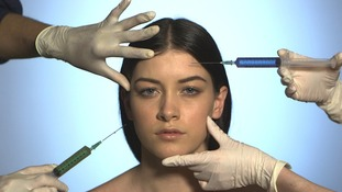 Lady poised for injections into face