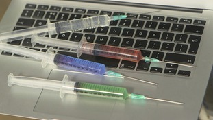 Syringes on a laptop
