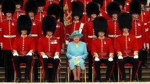 Queen Elizabeth II, Colonel-in-Chief, Grenadier Guards, has her photo taken with Guards after inspecting The Queen's Company