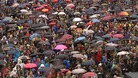 Thousands of people gathered in the rain to sing 'Children of the Rainbow' outside Breivik's courtroom.