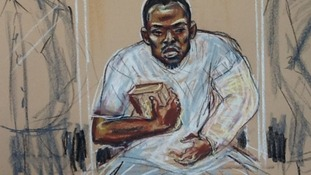 Michael Adebolajo seen during a previous court appearance holding a copy of the Koran