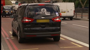 Addison Lee car driving in bus lane