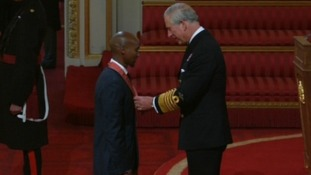 Olympian Mo Farah receives his CBE from Prince Charles at Buckingham Palace.
