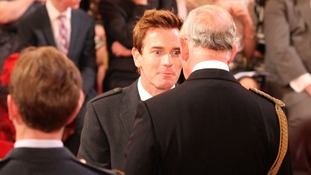 Actor Ewan McGregor speaks to Prince Charles as he receives his OBE at Buckingham Palace.