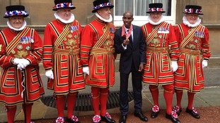 Mo Farah poses with Beefeaters after receiving his CBE.