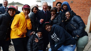 The Prince of Wales poses for photographs with local youths who take part in Prince's Trust activities