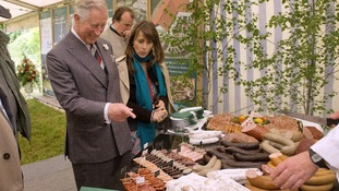 The Prince of Wales inspects sausages at a symposium for highlighting the development of regional produce