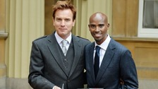 Ewan McGregor and Mo Farah show off their honours outside Buckingham Palace.