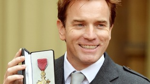 Ewan McGregor shows off his OBE and praised the work of the volunteers at Unicef and GoCampaign