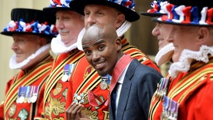 Mo Farah jokes around with Beefeaters after receiving his CBE.