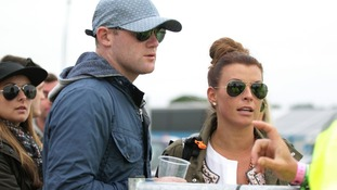 Wayne and Coleen Rooney are stopped by security at Glastonbury