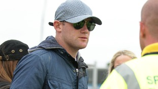 Wayne Rooney is turned away by security guard