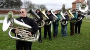 Tuba players warm-up for Tubarama world record attempt