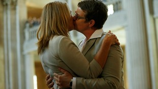 Sandy Stier (L) and Kris Perry kiss after being married