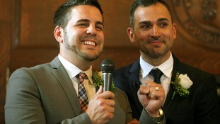 Jeff Zarrillo (L) speaks after getting married to his partner Paul Katami