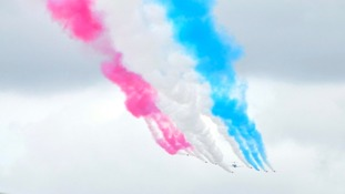 Red Arrows' signature tail smoke.