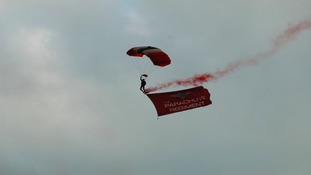 Hang glider from parachute regiment flying in against cloudy skies