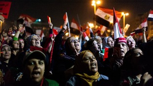A large group of women take to the front of a gathering of opposition supporters in Cairo