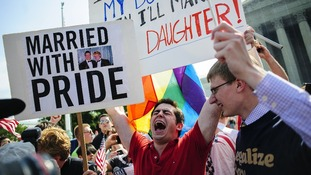 David Baker, 24 of Phoenix, Arizona, celebrates outside the Supreme Court