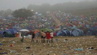 Festival goers survey the camp site at Worthy Farm