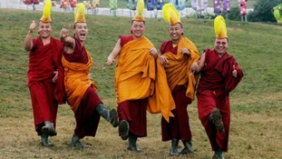 The Gyuto Monks of Tibet pose with wellies at Glastonbury