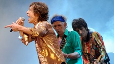 Mick Jagger, Keith Richards and Ronnie Wood from the Rolling Stones perform on the Pyramid Stage