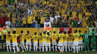 Brazil wave to the crowd after their victory over Spain