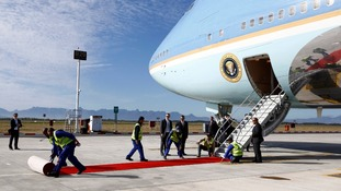 Rolling up the red carpet next to Air Force One in Cape Town, South Africa