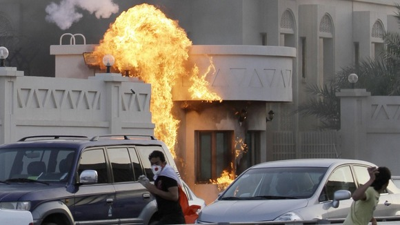 Bahraini anti-government protesters throw petrol bombs at a police station