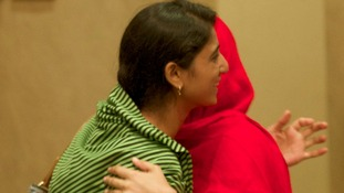 Malala Yousufzai (right) and Shazia Ramzan meet for the first time since the Taliban attack in Pakistan.