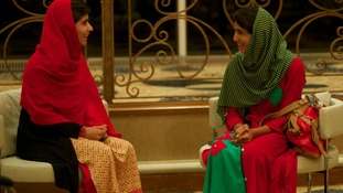Malala Yousufzai (left) and Shazia Ramzan smile and chat as they are reunited.