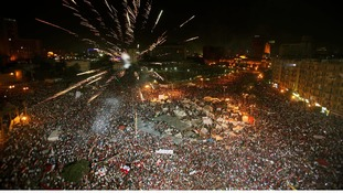 Anti-government protesters light fireworks at Cairo's Tahrir Square.
