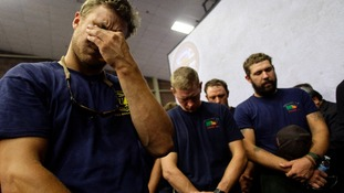 Firefighters mourn during a moment of silence for the 19 firefighters who died at a memorial service in Prescott, Arizona