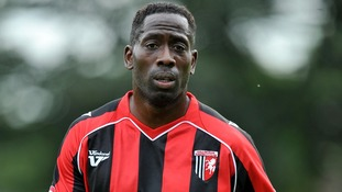 Former Gillingham player Mark McCammon reported a racist and threatening message to police.