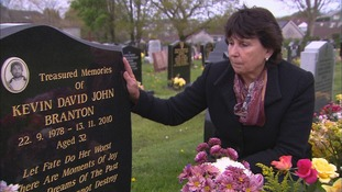 Denise Branton at the grave of her son, Kevin